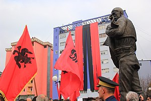 Flag of Albania - Albanian centenary celebrations, 2012, with deformed-eagle flag visible on the left.