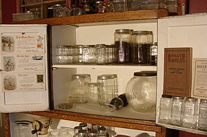 Sneath Glass Company - A collector's Hoosier Cabinet filled with Sneath Glass Company products.