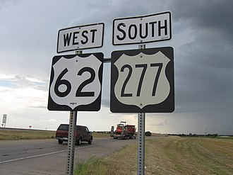 U.S. Route shield - Modern (left) and 1961 (right) shields in Newcastle, Oklahoma; the older shield uses the FHWA Series A typeface, which has since been discontinued.