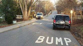 Speed bump - Speed bump and warning signs