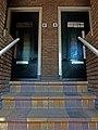Spoorstraat 6, 6a, 8, 10, Gouda (voordeuren en trap).jpg