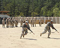 Spouses of U.S. Soldiers endure training in tactical Warfare for a day during the Combat Spouse's day event at the Forward Operating Base on, Fort Gordon Ga 090421-A-NF756-002.jpg