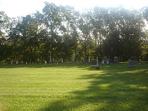 History of Markham, Ontario - Full view of the St. John's Lutheran Cemetery behind the Buttonville Women's Institute Community Hall in Markham. The cemetery dates to the 1820s.