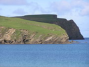 Cliffs of St. Ninian's Isle, photographed on 24 May 2006. The St. Ninian's Isle treasure, which is believed to date to about 800 A.D., was found on this island.