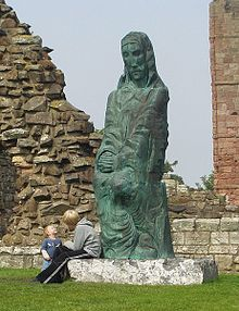 Statue of St Cuthbert by Fenwick Lawson, Lindisfarne Priory - geograph.org.uk - 1239259.jpg