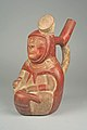 Stirrup Spout Bottle with Seated Figure MET 64.228.36.jpeg
