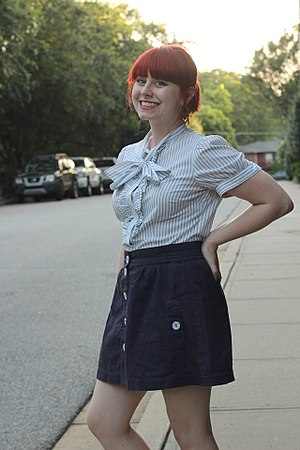 Blouse - A modern striped bow tie neck blouse and a navy blue mini skirt.