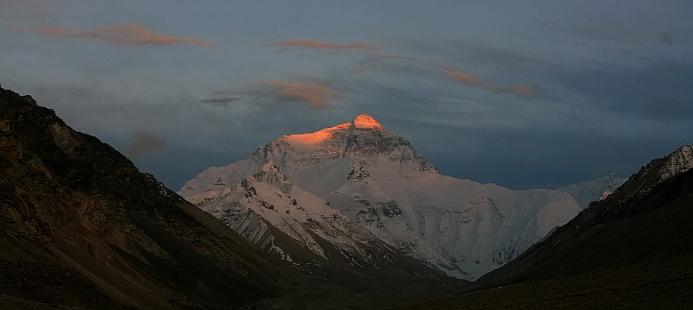 Sunset lights up the peak of Everest's North face