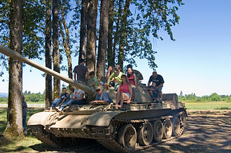 Evergreen Aviation & Space Museum - Kids climb on a Soviet T-55 behind the main building.