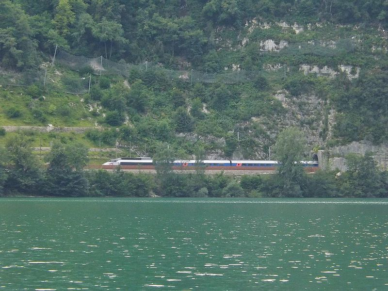 Sight of a French TGV high speed train, coming from Geneva (Switzerland) and moving towards Paris, is here passing next to the lac de Nantua lake, in Ain (France).