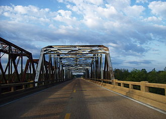 Mississippi Highway 7 - Highway 7 and rarely used Mississippi Central Railroad bridges over the Tallahatchie River at the Lafayette-Marshall county line. This sweeping bottomland, located approximately halfway between Holly Springs and Oxford, was the inspiration for fictional settings in several works by William Faulkner. This bridge was replaced and removed in 2015.
