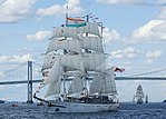 Three-masted ship with sails unfurled
