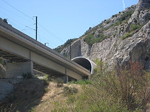 Piston effect - A tunnel in the French high-speed TGV network with an entrance hood to mitigate tunnel boom.