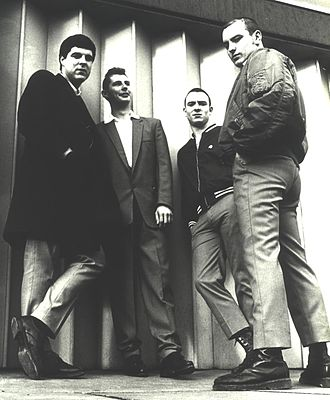The 4-Skins - The classic 4-Skins line-up, McCourt, Pear, Jacobs and Hodges, outside Tower Hill tube station, 1980