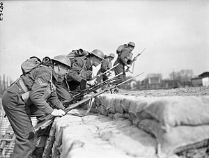 7th Infantry Brigade and Headquarters East - Guardsmen of King's Company, 1st Battalion, Grenadier Guards go 'over the top' during training at Annappes, France, 8 April 1940.