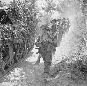 5th (Huntingdonshire) Battalion, Northamptonshire Regiment - Men of the 5th (Huntingdonshire) Battalion, Northamptonshire Regiment on the march near Coldragone, Italy, 25 May 1944.