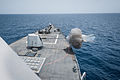 The Mark 45 5-inch lightweight gun aboard the guided missile destroyer USS Stockdale (DDG 106) is fired during a live-fire exercise Aug. 13, 2013, in the U.S. 5th Fleet area of responsibility 130813-N-HN991-014.jpg
