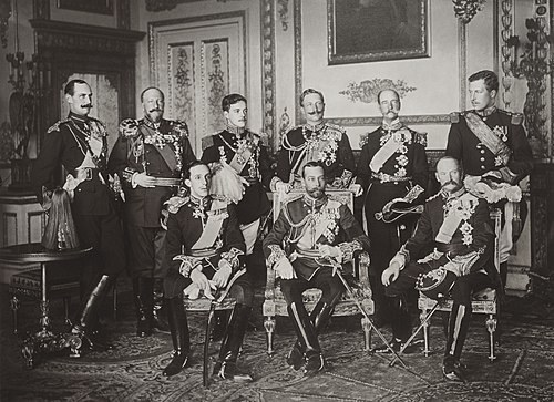 The Nine Sovereigns at Windsor for the funeral of King Edward VII, photographed on 20 May 1910. Standing, from left to right: King Haakon VII of Norway, Tsar Ferdinand of the Bulgarians, King Manuel II of Portugal and the Algarve, Kaiser Wilhelm II of Germany and Prussia, King George I of the Hellenes and King Albert I of the Belgians. Seated, from left to right: King Alfonso XIII of Spain, King George V of the United Kingdom and King Frederick VIII of Denmark. The Nine Sovereigns at Windsor for the funeral of King Edward VII.jpg