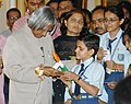 The President, Dr. A.P.J. Abdul Kalam being presented a memento by school children after they tied Rakhi on the occasion of Raksha Bandhan in New Delhi on August 09, 2006.jpg