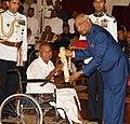 The President, Shri Ram Nath Kovind presenting the Padma Shri Award to Shri Damodar Ganesh Bapat, at the Civil Investiture Ceremony-II, at Rashtrapati Bhavan, in New Delhi on April 02, 2018.jpg