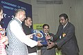 The Union Minister of Mines, Shri Sis Ram Ola presenting the National Mineral Awardees-2004 to one of the awardee, in New Delhi on March 8, 2006. Minister of State for Mines Dr. T. Subbarami Reddy is also seen.jpg