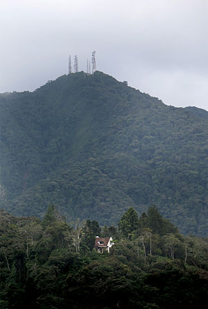 "Cameron Highlands District - Mount (Gunung) Batu Brinchang:  ""Moonlight"" bungalow is in the foreground. The radio and television station is at the peak of the mountain. Photo credit: Time Tunnel museum."