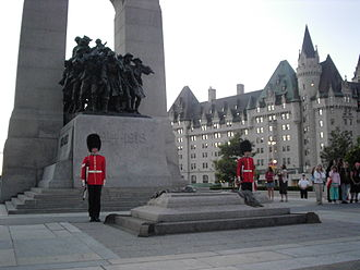 Canadian war memorials - Ceremonial Guard stand watch over Canada's national memorial, The Response, with the Tomb of the Unknown Soldier in the foreground.