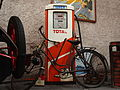 Total, old petrol pump with bicycle parked in front of it, pic2.JPG