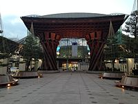 Tsuzumimon Gate in front of Kanazawa Station at dusk 20150120.JPG