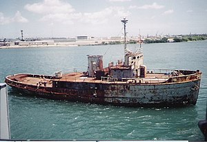 USS Tunica (ATA-178) - The salvage training hulk Tunica in Pearl Harbor, Hawaii, April 1996