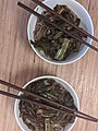 Two bowls of soba noodles with chopsticks.jpg