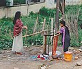 Two girls in Nepal do the dishes.jpg
