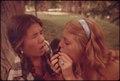 Two girls smoking pot during an outing in Cedar Woods, Texas - NARA - 554909.tiff