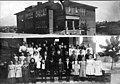 Two part photograph of the Pacific School building and a group portrait of students of the school, 1909 (SEATTLE 5907).jpg