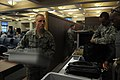U.S. Air Force Airman 1st Class Lance Mitchell, left, a passenger service agent with the 724th Air Mobility Squadron, returns bins to the front of a checkpoint in the passenger terminal at Aviano Air Base 130515-F-BH566-122.jpg