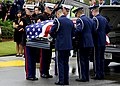 U.S. Airmen and Marines lift retired U.S. Air Force Col. George Day's casket during a funeral service at Naval Air Station Pensacola, Fla., Aug. 1, 2013 130801-F-HG908-195.jpg