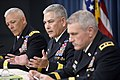 U.S. Army Gen. John F. Campbell, center, briefs the media on specific impending cuts and realignments within the Army's force structure during a press conference in the Pentagon in Arlington, Va., on June 25, 2 130625-D-NI589-311.jpg