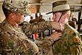 U.S. Army Lt. Col. Anthony Noll, left, the deputy commander of Combined Team Uruzgan, pins an Army Commendation Medal on the uniform of Australian Army Maj. Rebecca Gordon Aug. 7, 2013, at Multinational Base 130807-O-MD709-158-AU.jpg