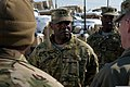 U.S. Army Maj. Gen. Darrell Williams, center, the commanding general of the 1st Theater Sustainment Command, visits Bagram Airfield, Afghanistan, Feb. 7, 2014, to observe and discuss retrograde operations 140207-A-ZA744-095.jpg