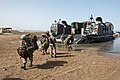 U.S. Marines with the 26th Marine Expeditionary Unit get out of a landing craft, air cushion during Eager Lion 2013 in the Gulf of Aqaba June 6, 2013 130606-N-WX580-123.jpg