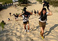 U.S. Naval sea cadets climb a steep hill of sand on U.S. Army base Fort Story in Virginia Beach, Va., after swimming two miles up the coastline during explosive ordnance disposal (EOD)-diving training July 12 060712-N-EZ704-002.jpg