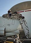 U.S. Navy Aviation Machinist's Mate 3rd Class Christine Choi and Logistics Specialist 3rd Class Verly Dolce perform maintenance on the wing of an E-2C Hawkeye aircraft assigned to Carrier Airborne Early Warning 130813-N-LP801-084.jpg