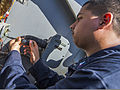 U.S. Navy Electrician's Mate 3rd Class Francisco Miranda performs routine maintenance aboard the guided missile destroyer USS Gravely (DDG 107) May 23, 2013, in the Mediterranean Sea 130523-N-KA046-075.jpg