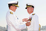 U.S. Navy Rear Adm. Patrick Hall, left, the commander of Carrier Strike Group 9, presents Capt. Thom Burke with an award during a change of command ceremony aboard the aircraft carrier USS Ronald Reagan (CVN 76) 130813-N-HT107-118.jpg