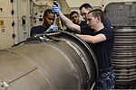 U.S. Sailors repair aircraft components aboard the aircraft carrier USS Nimitz (CVN 68) June 18, 2013, in the Gulf of Oman 130618-N-TW634-304.jpg