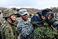 US Army and JGSDF exchange chemical decon techniques during Orient Shield 14 141028-A-WG123-007.jpg