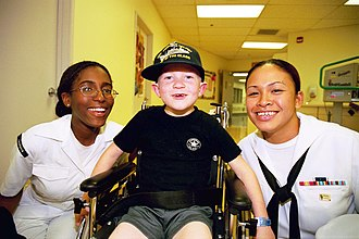 USS Frederick (LST-1184) - U.S. Navy sailors from the USS Frederick visiting an Oregon hospital in June 2002.