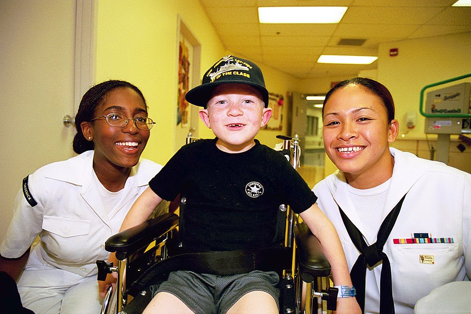 US Navy 020607-N-9022M-001 visit with children at Portland Shiners Hospital
