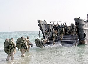 40 Commando - Royal Marines from the 40th Commando unit load onto a Landing Craft Utility (LCU) following intensive training in the Kuwaiti Desert.