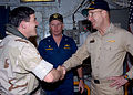 US Navy 030418-N-4048T-100 Capt. Gregg Jackson, Commander, Amphibious Squadron Eight, welcomes Master Chief Petty Officer of the Navy.jpg